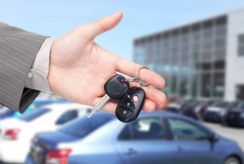 car key in front of the car