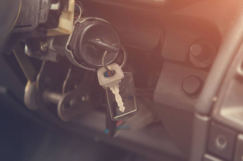 keys in the ignition of an old car