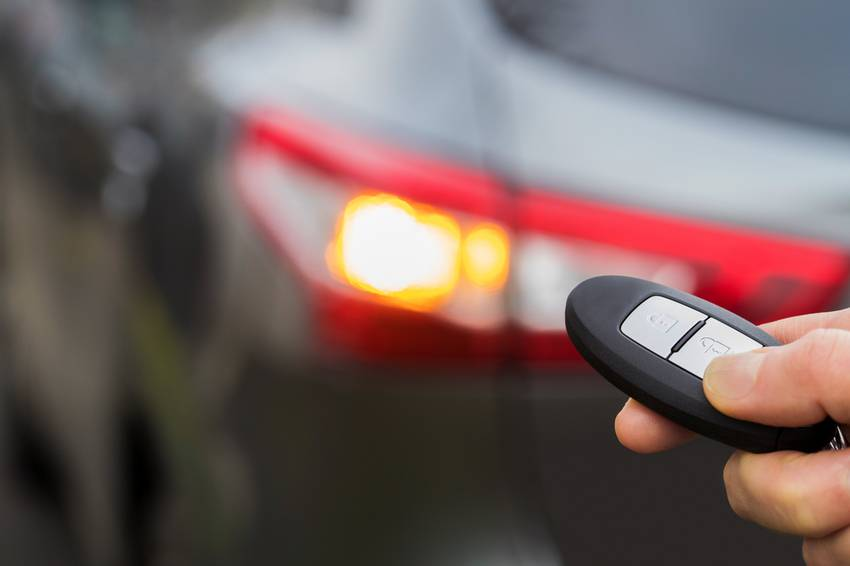 car key fob in front of car