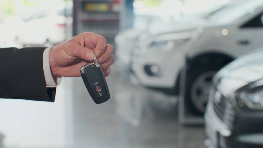 car key fob in front of cars